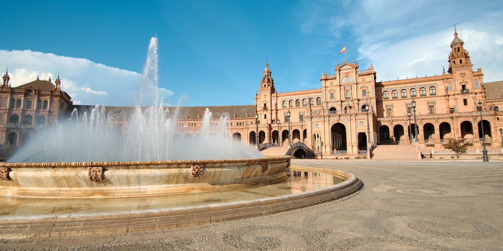Panoramic view of fountain building against sky