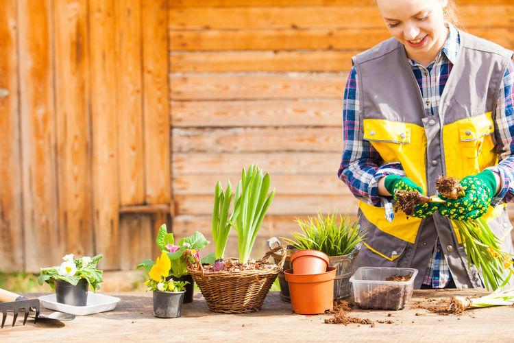 Woman gardening at shop