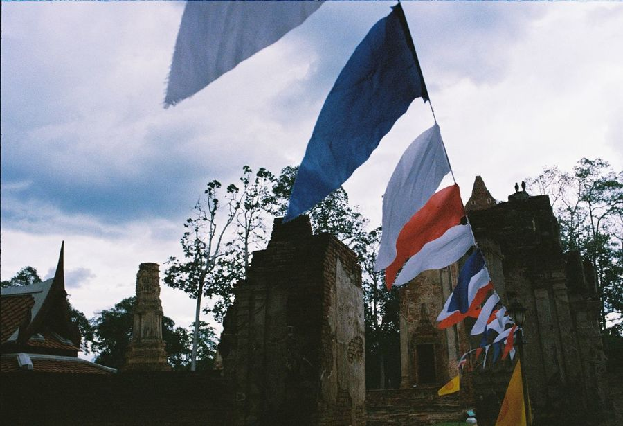 Miles Away Patriotism Flag Sky Low Angle View Outdoors Architecture Building Exterior Thailandtravel Analog ThailandOnly Colour Of Life Analogphotography Ishootfilm Filmphotography Filmsnotdead Filmisalive Lifestyles Eyeemphoto Kodakfilm Kodakcolorplus200 OM1 Built Structure Sculpture Day Art Is Everywhere EyeEmNewHere Live For The Story The Great Outdoors - 2017 EyeEm Awards The Architect - 2017 EyeEm Awards