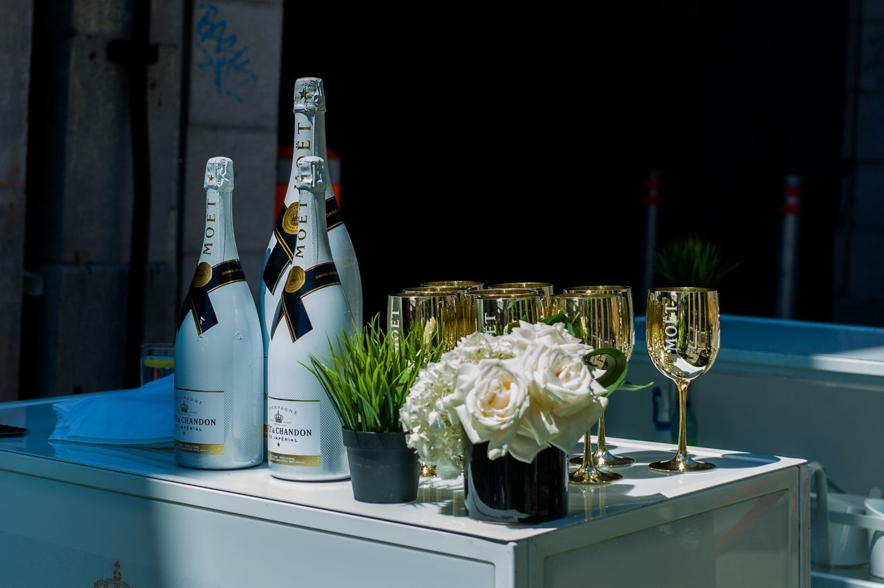 bottle, wine bottle, wine, food and drink, wineglass, alcohol, drink, no people, champagne, indoors, table, champagne flute, drinking glass, flower, freshness, close-up, day