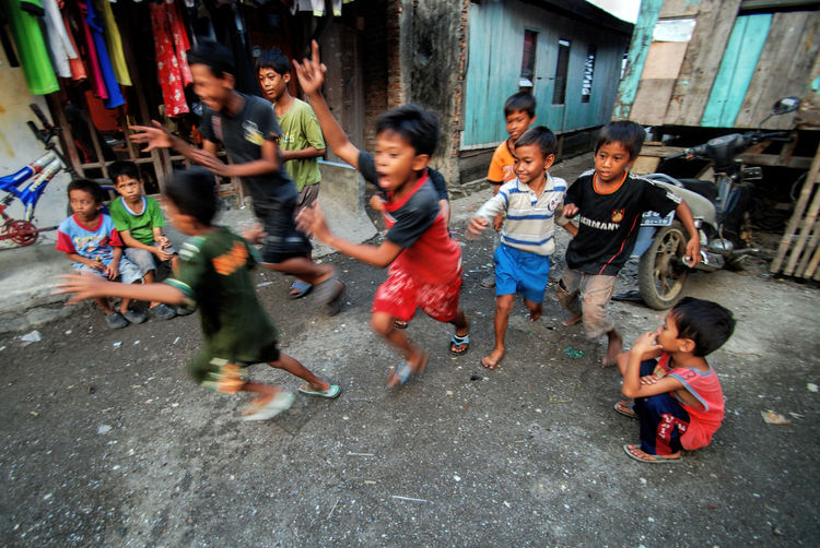 Children playing in market