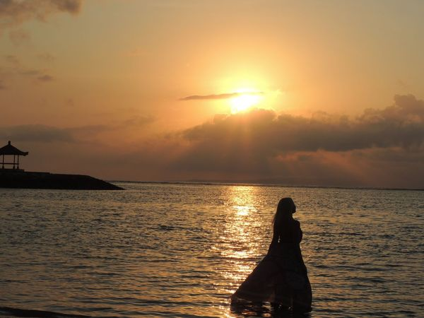 """When the Sun Rising"" Sunrise Sunlight Girl Woman Outdoor Photography Baliphotography Bali, Indonesia Bali Beach Orange Sky Nature Beautiful Woman Gazebo Water Sea Beach Beauty Silhouette Sun Multi Colored Adventure Seascape Dramatic Sky Shining Forked Lightning Moody Sky Atmospheric Mood Romantic Sky Tide Wave Calm"