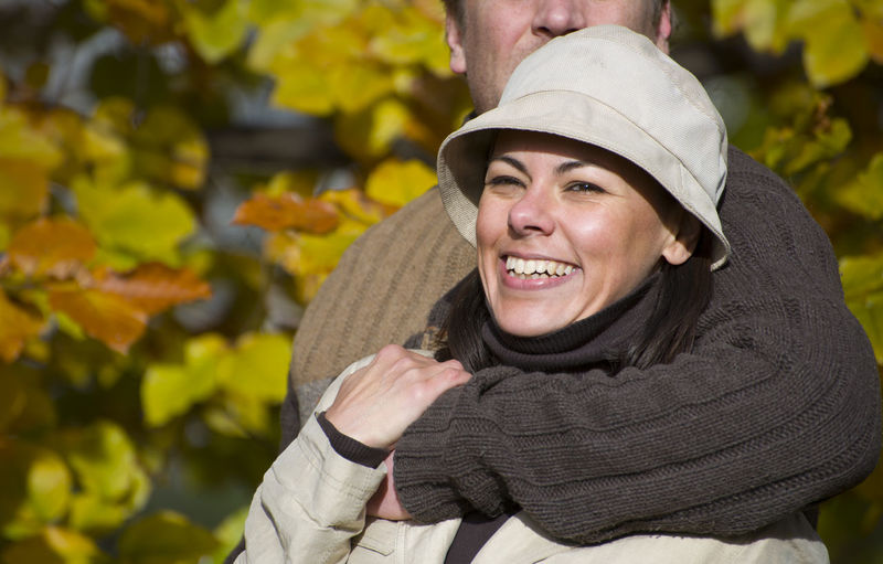 Cropped Image Of Man Embracing Smiling Mature Woman