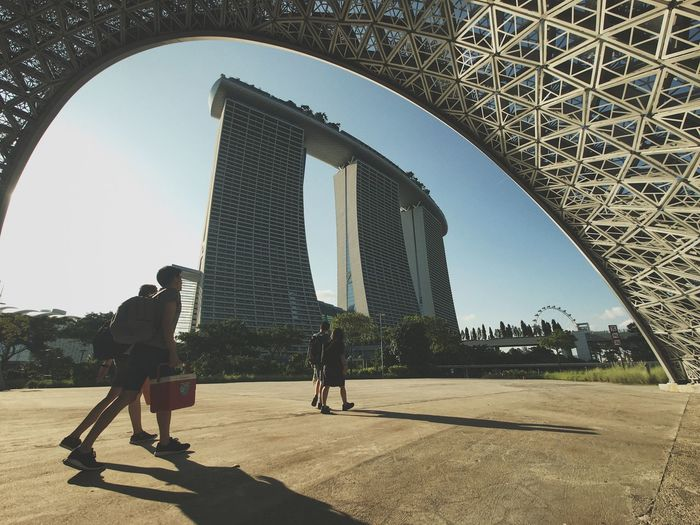 People walking on modern building