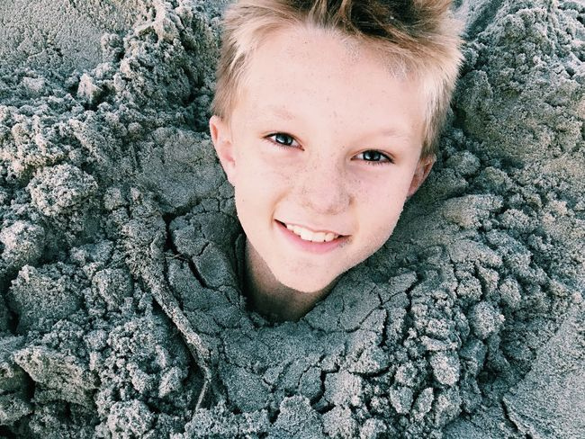 Looking At Camera Portrait Smiling High Angle View Toothy Smile Happiness One Person Close-up Headshot Front View Blond Hair Childhood Real People Outdoors Lifestyles Young Adult Cheerful Day People Sand Sand Dune