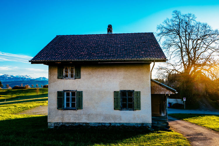 Architecture Bare Tree Blue Building Exterior Built Structure Clear Sky Day Field Gormund Grass Growth House Kapelle Lawn Nature No People Outdoors Residential Structure Shadow Sky Sunlight Tree