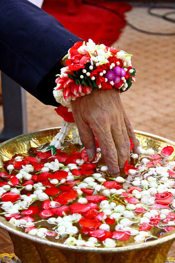 Close-up of hand holding bouquet