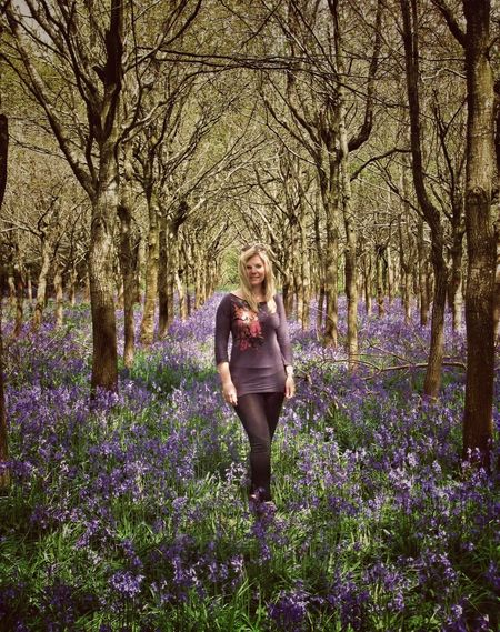 Young lady amongst Bluebells Flower Tree Leisure Activity Bare Tree Lifestyles Beauty In Nature Person Growth Season  Casual Clothing Blurbells Bluebell Wild Flowers Countryside Woods Forest Young Woman Young Lady naturFragilitytFront VieweScenicscDayaTranquil ScenenTranquilitytNon-urban Scenene