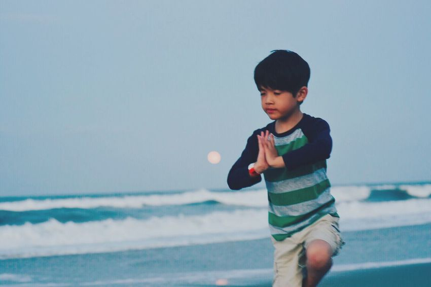 Live For The Story Yoga Pose Childhood Real People One Person Leisure Activity Sea Sky Casual Clothing Outdoors Beach Elementary Age Water Nature Horizon Over Water Summer Boy Tree Pose