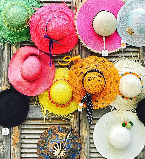 Straw Hats For Sale Fashion Hanging Happy Shutters Summer Hats Close-up Day Easter Green Hat Hats Multi Colored Night Market No People Orange Hat Pink Hat Straw Hats Yellow Hat Travel Destination