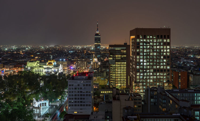 Torre latinoamericana amidst buildings in city at night