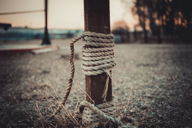 Rope tied to wooden pole