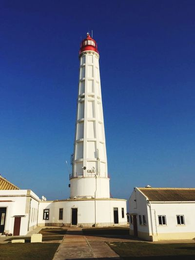 Lighthouse Architecture Built Structure Building Exterior Tower Sky Clear Sky Guidance Building Lighthouse No People Day Safety Protection Blue Direction Nature Security Low Angle View Sunlight Travel