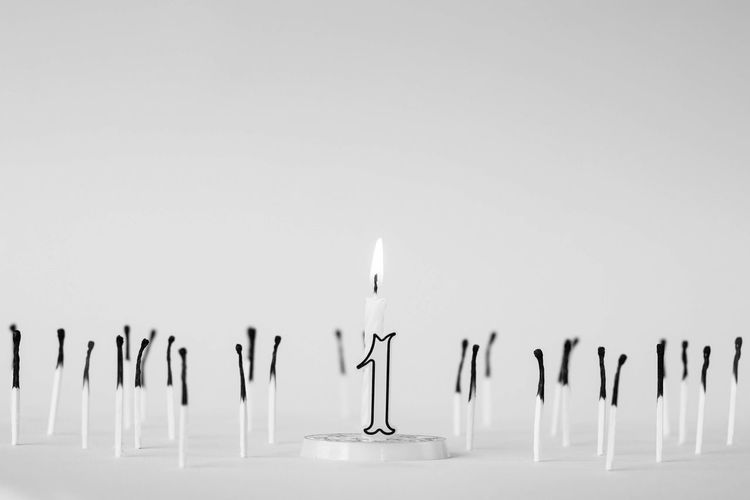 Close-up of candles against white background