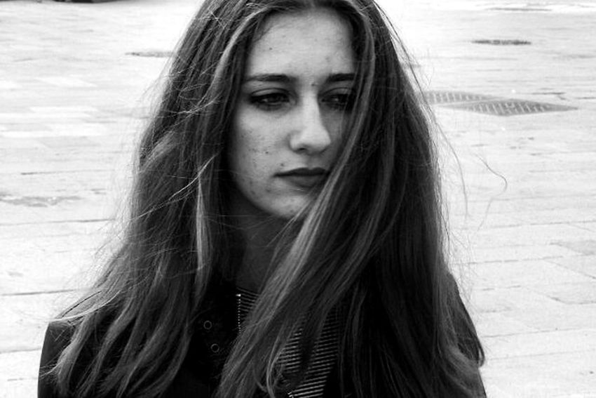 EyeEmNewHere Long Hair One Person Only Women One Woman Only Day Headshot Adults Only Beautiful Woman Beauty Adult Portrait One Young Woman Only Young Adult People Outdoors Close-up Human Body Part Real People Young Women Women Standing Human Face Redhead Indoors  The Portraitist - 2017 EyeEm Awards Black And White Friday Love Yourself Press For Progress