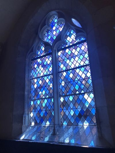 Window Indoors  Day Built Structure No People Architecture Blue Light Light And Shadow IPhone Photography IPhoneography Eye4photography  EyeEm Gallery EyeEmBestPics EyeEm Iphone7 IPhone Iphonephotography Stained Glass Stained Glass Window Sunlight Light And Shadows Church Building Place Of Worship