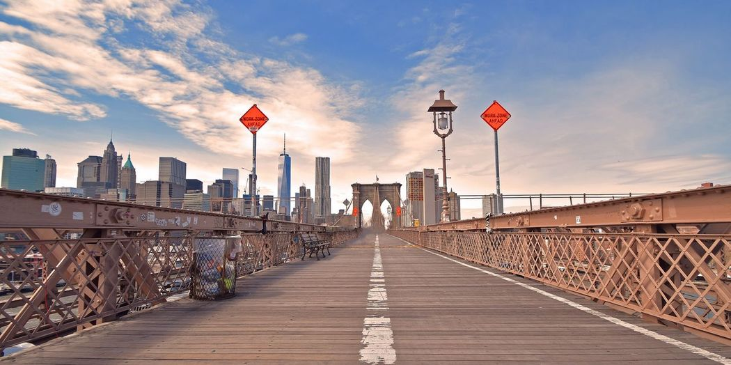 Empty Walkway On Brooklyn Bridge Against Sky