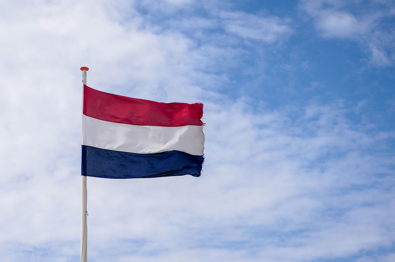 Netherlands Blue Cloud - Sky Dutch Emotion Flag Independence Low Angle View National Icon No People Patriotism Pole Pride Red Sky Striped Waving White Color Wind