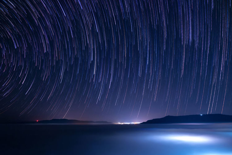 Space Star - Space Night Astronomy Scenics - Nature Beauty In Nature Sky Long Exposure Water Star Trail Motion Galaxy Tranquility No People Tranquil Scene Nature Sea Star Field Idyllic Purple Milky Way Space And Astronomy