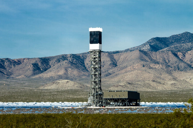 Solar thermal power plant against mountains