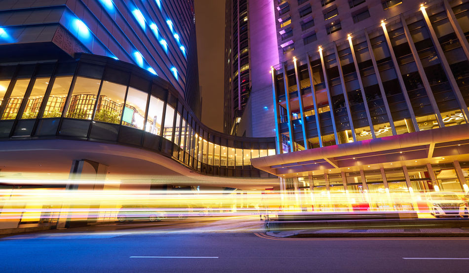 Architecture City Illuminated Built Structure Building Exterior Night Long Exposure Motion Road Blurred Motion Transportation Light Trail Speed Building Street City Life Office Building Exterior No People Modern Lighting Equipment Outdoors Light Skyscraper Nightlife Purple