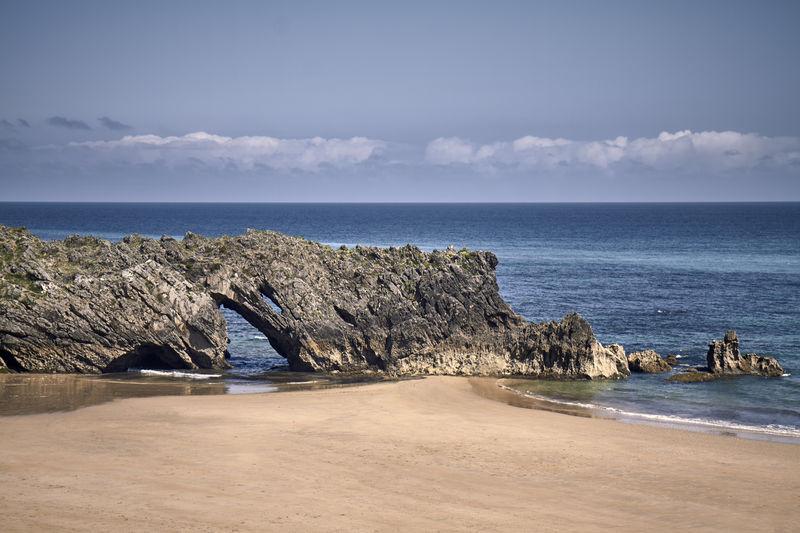 Swell on a coast beach on a cloudy day