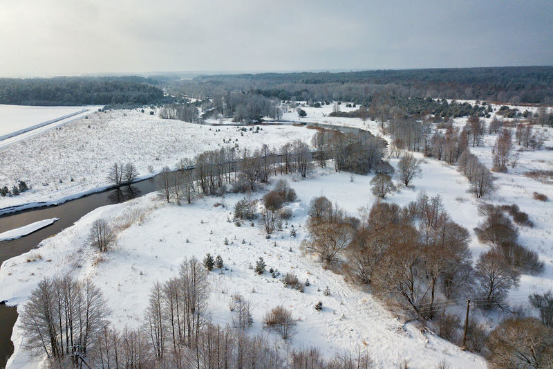 Panoramic view of landscape against sky during winter