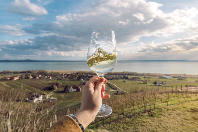Badacsony Badacsony Wine Region Balaton - Hungary Hungary Travel Alcohol Balaton Cloud - Sky Day Drink Drinking Glass Food And Drink Holding Human Body Part Human Hand Landscape Nature One Person Outdoors Personal Perspective Real People Sky Water Wine Wineglass