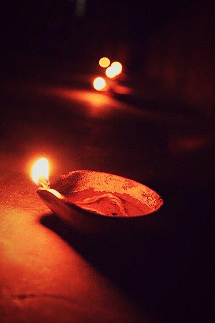 illuminated, night, no people, flame, burning, diya - oil lamp, oil lamp, heat - temperature, indoors, diwali, black background, close-up, astronomy