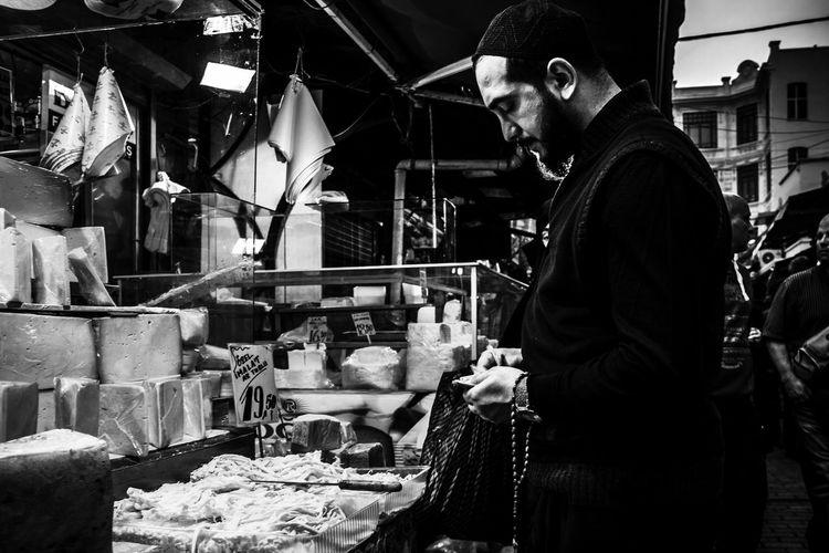 Istanbul Grand Bazaar Adult Adults Only Agriculture Bazaar Business Finance And Industry Candid City Life Food Freshness Grandbazaar  Indoors  Istanbul Istanbulgrandbazaar Market Market Market Stall Night Occupation One Man Only One Person Only Men People Real People Small Business Working Welcome To Black