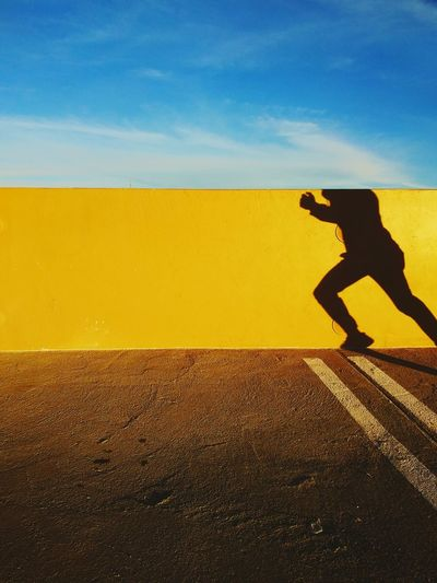 Running Yellow Shadow Side View Silhouette Standing Sky Focus On Shadow Paved
