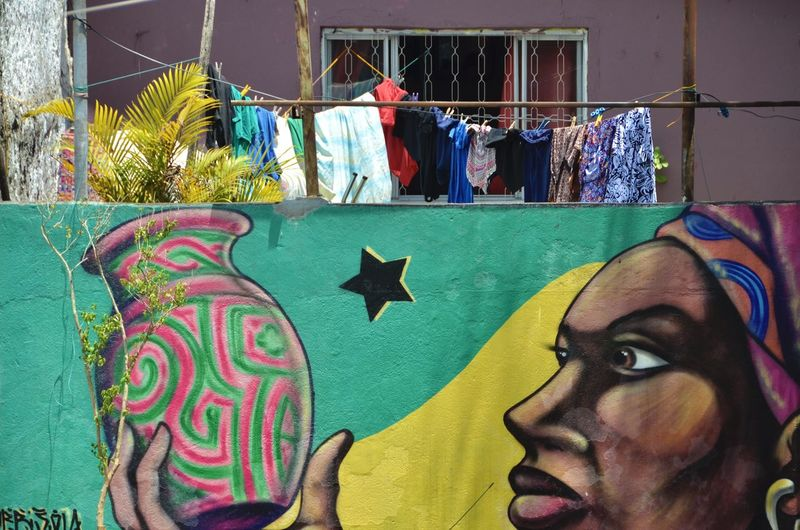 Portrait of woman painting on graffiti