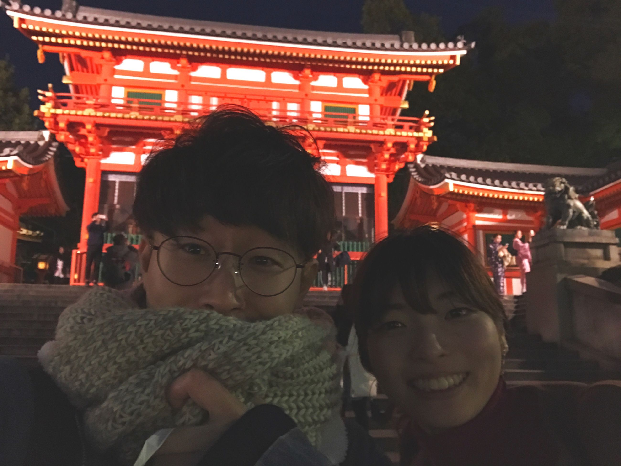 real people, lifestyles, architecture, building exterior, illuminated, two people, front view, built structure, leisure activity, city, eyeglasses, night, men, outdoors