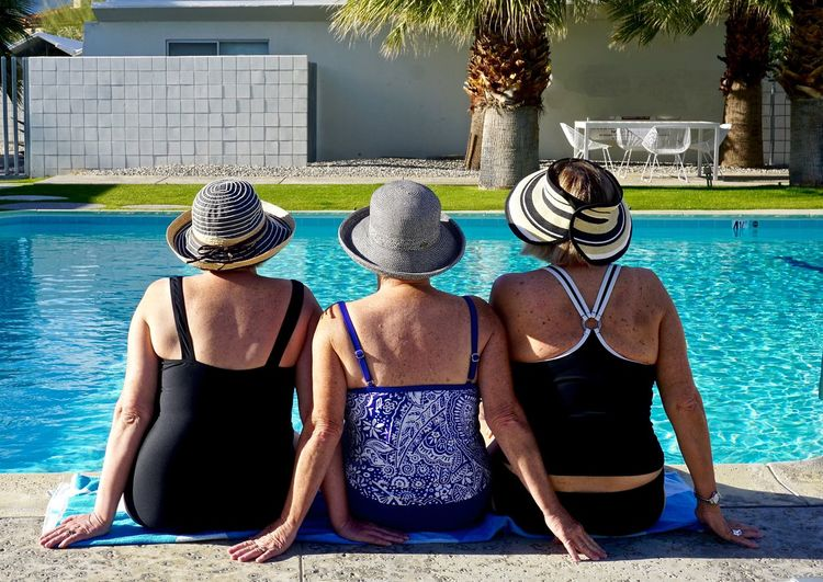 Rear view of women at swimming pool