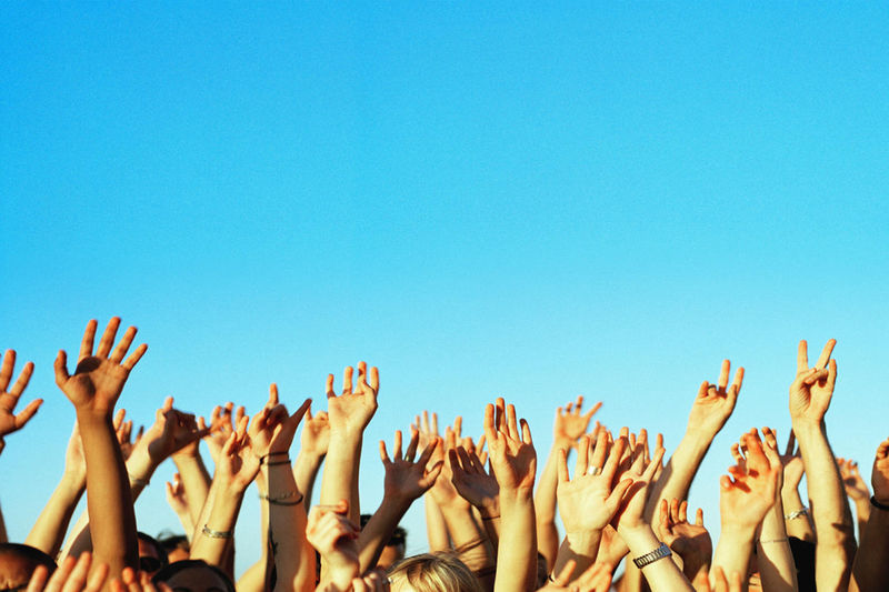 Arms Raised Arts Culture And Entertainment Audience Blue Clear Sky Copy Space Crowd Day Enjoyment Excitement Fan - Enthusiast Fun Human Arm Human Body Part Human Hand Large Group Of People Music Music Festival Outdoors Popular Music Concert Real People Vitality Women Young Adult Youth Culture