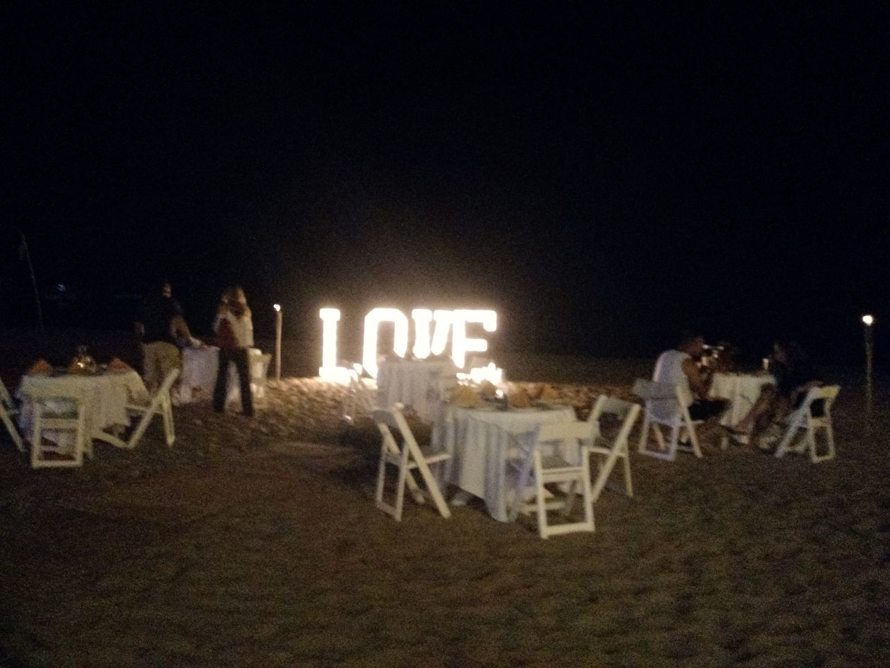 large group of people, night, sand, beach, outdoors, illuminated, men, women, real people, sky, people
