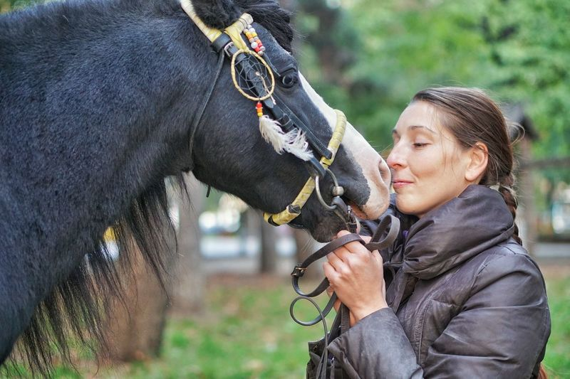 Side View Of Woman And A Horse