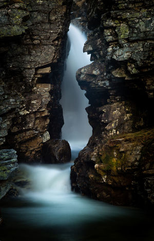 Waterfall in a rock cleft. Rock Water Motion Long Exposure Rock Formation Blurred Motion No People Beauty In Nature Scenics - Nature Nature Waterfall Outdoors Flowing Water Power In Nature Flowing Norway Contrast Beautiful Cold Mountain Eroded EyeEmNewHere