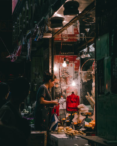 late night at Temple Street Market, Hong Kong Wet Market ASIA Hong Kong Night Market Gritty Street Photography Street Night Photography Portrait Portrait Of A Woman Store Market Retail  Street Scene Market Stall Street Market Market Vendor