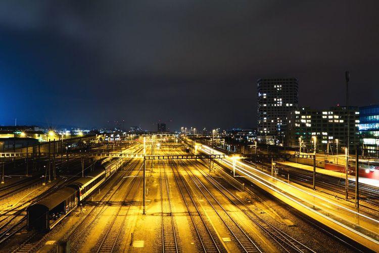 High angle view of railway tracks at night