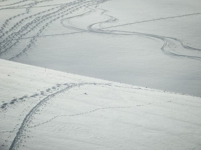 High Angle View Of Ski Tracks On Snowcapped Mountains