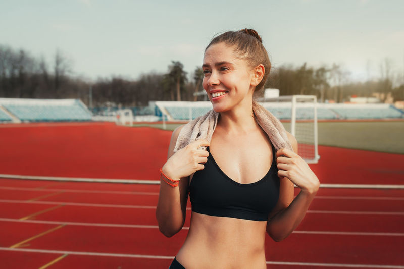 Female Athlete Standing On Running Track