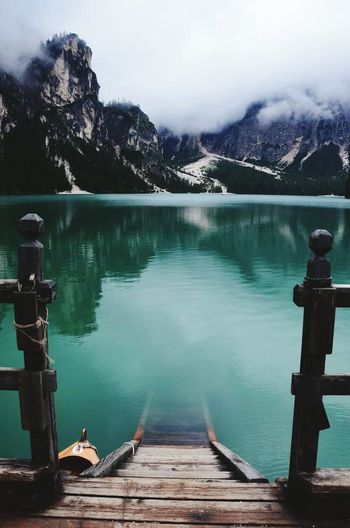 View Of Sunken Pier In Lago De Braies Against Mountain Range In South Tyrol, Italy
