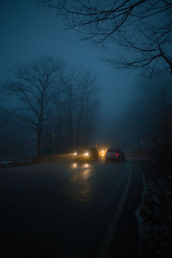 Cars on road at night during winter