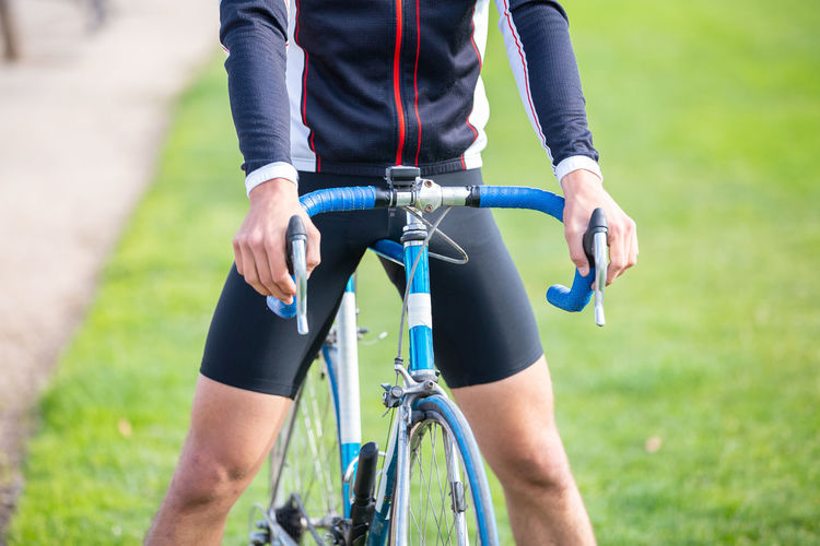 Midsection of man riding bicycle