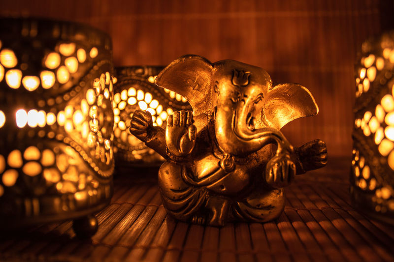 Golden ganesha figure with candle light Wallpaper Background Bronze Bronze Statue Diwali Ganesha Ganesh Golden Figure Candlelight Warm Elephant Yoga Zen Bright Spiritual Gold Buddhism Gold Gold Colored Celebration Close-up Mythology Statue Darkroom First Eyeem Photo Candle