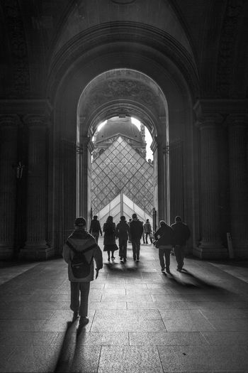 Arch Architectural Column Architecture Built Structure City Life Column Corridor Day Full Length Group Of People Leisure Activity Lifestyles Men The Way Forward Tourism Travel Destinations Walkway