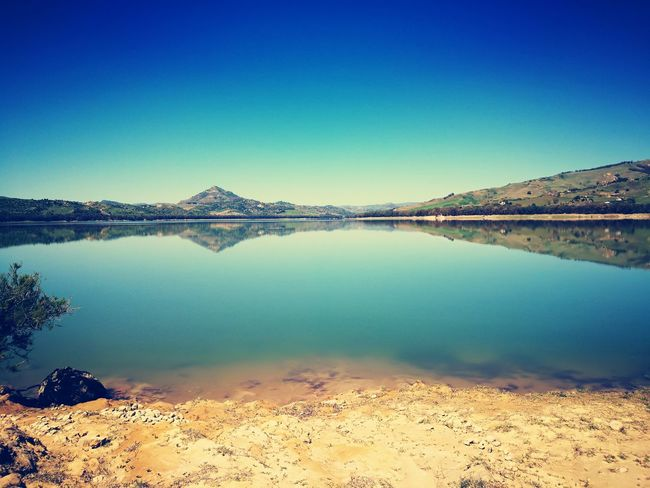 The Great Outdoors - 2017 EyeEm Awards Lake Water Reflection Nature Landscape Tranquility Standing Water Blue Mountain Clear Sky Sky Salt Basin Salt Flat Outdoors Scenics Day Salt - Mineral Beauty In Nature No People Desert EyeEm Selects Breathing Space