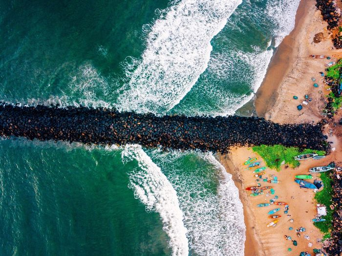 Aerial View Of Stone Pier At Beach