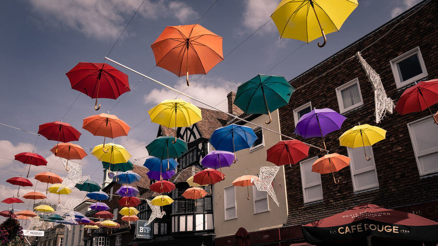 Multi Colored Umbrella Protection Hanging Built Structure Architecture Low Angle View Building Exterior Sky Security Decoration No People Nature Outdoors Day City Variation Choice Building EyeEm Best Shots Eye4photography  My Best Photo